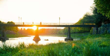 View of bridge on river Uzh at city Uzhgorod, Transcarpathia, Ukraine Europe. Amazing sunset time Stock Photo