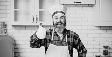 Male chef in uniform. Cook with taste approval gesture.