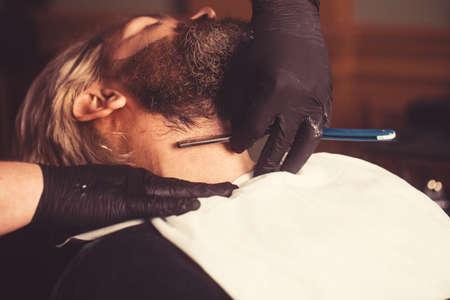 Barber scissors, barber shop. Vintage barbershop, shaving. Portrait of shaves mans 免版税图像