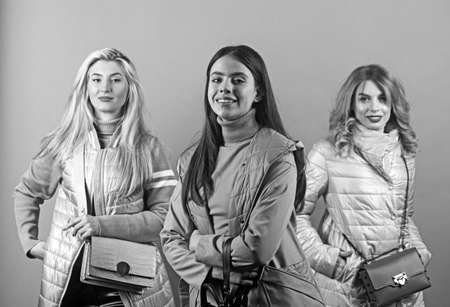 3 happy casual women posing and smile, isolated on gray background. Foto de archivo