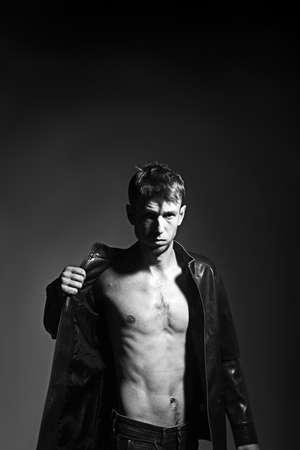 Slim thin torso of athletic man in leather jacket. Stock fotó