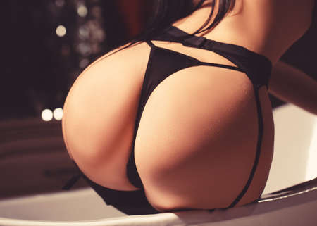Beautiful womans body. Sexy in thong closeup. Stockfoto