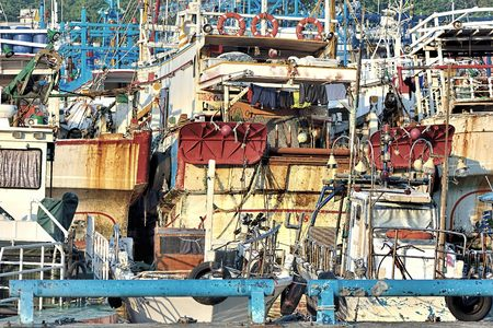 mess: Old and mess cargo ships Stock Photo