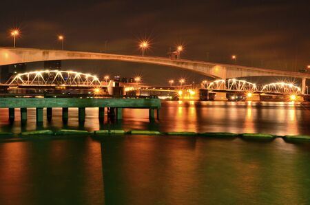 a bridge is big , cross a river , night in Bangkok , Thailand ,