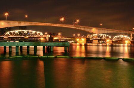 a bridge is big , cross a river , night in Bangkok , Thailand ,