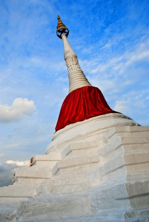 the pagoda is slant [ lean ] white with red cloth  the tourist attraction in Thailand