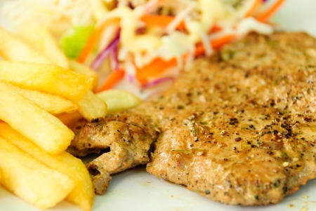 stek with french fries and vegetables