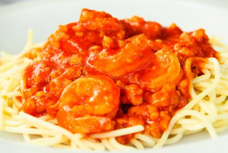 spaghetti chicken and the shrimp pour tomato sauce Stock Photo