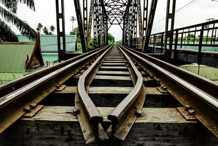 the railway on structure iron bridge has the house thai style stays the sideways Stock Photo