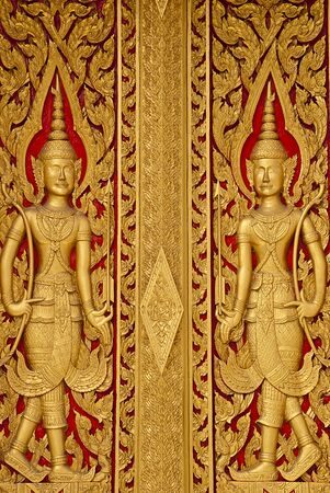 wood door carves in a temple of Thailand