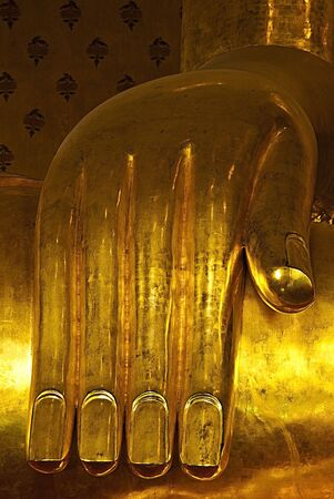 thaiart: the hand in the image of Buddha  at make of the brass Stock Photo