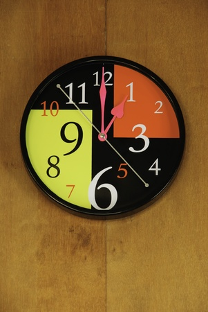 wall sphere clock is telling the afternoon oclock straight Stock Photo