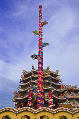 many dragons in Chinese temple and tall pole