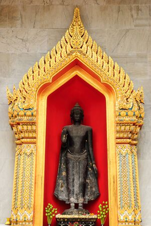 the image of Buddha infront a church and marble wall in Thailand
