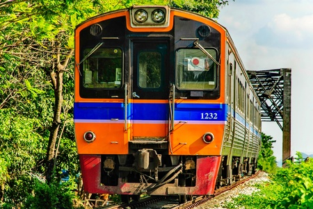 Thai train is running on the rail takes people