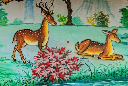 picture two deer painting on cement wall in a temple of Thailand