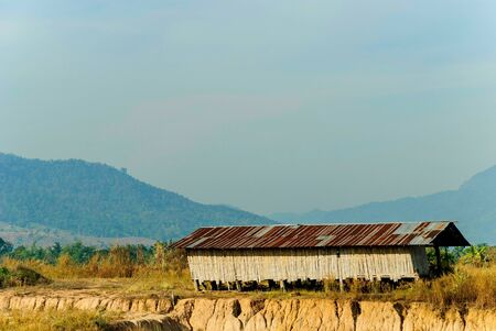 a house makes of the bamboo in way North countryside of Thailand