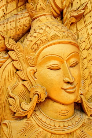 wood work carves angel gold face in temple of Thailand