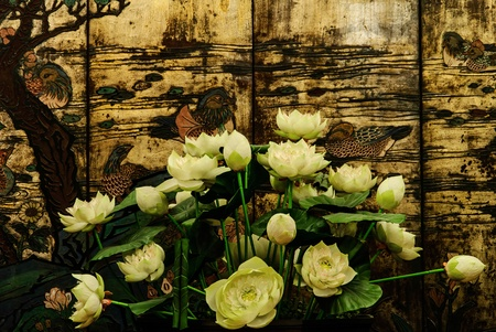 many plastic lotus with wood old picture teal painting Stock Photo