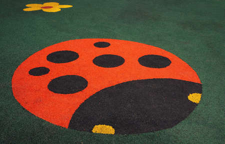 floor covering: Floor covering childrens playground with a ladybug                      Stock Photo