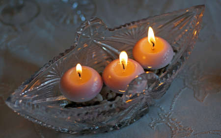 capacitance: Crystal capacitance with three burning candles                                Stock Photo