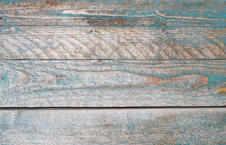 Texture of wall of blue boards with flaky paint                                    photo