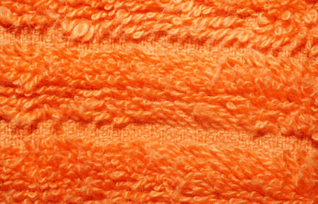 towelling: Texture of bright orange terry towels very closeup