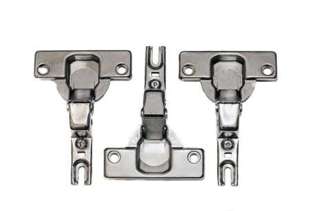 furniture hardware: Accesorios de mobiliario - bisagras sobre un fondo blanco Foto de archivo