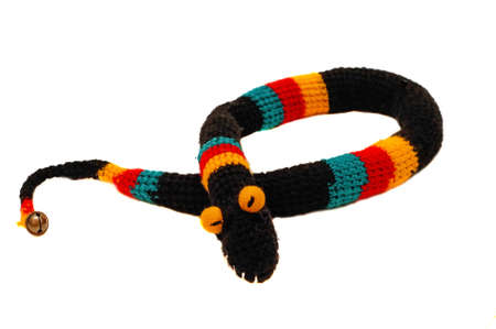 Knitted toy snake black with bright strips                                photo