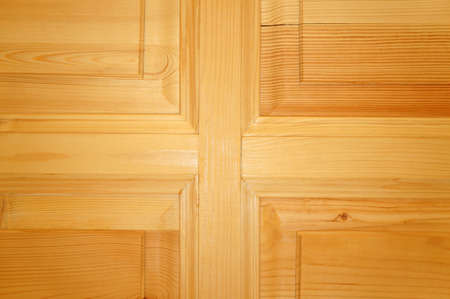 unpainted: The texture of the new unpainted wooden door as background