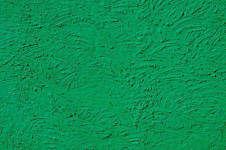 erratic: The texture of green walls painted large erratic strokes of paint