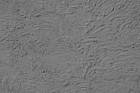erratic: The texture of gray walls painted large erratic strokes of pain