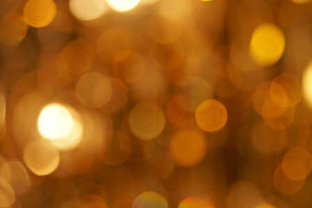 Defocused golden light spots as abstract background