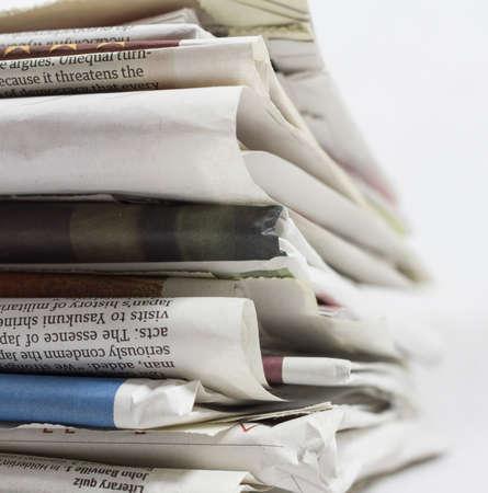 short phrase: Stack of Newspaper