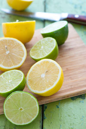 from halves: Halves of fresh limes and lemons Stock Photo