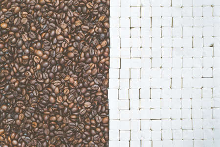 sugar cubes: Coffee beans and sugar cubes background, top view