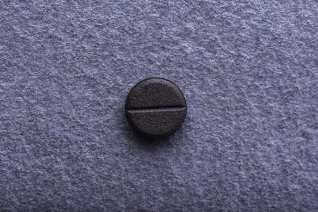 Closeup of the active angiar pill Stock Photo