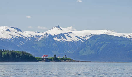 seclusion: Point Retreat Lighthouse at the northern end of Admiralty Island near Juneau, Alaska