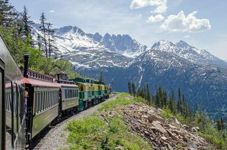 narrow gauge railroads: White Pass  Yukon Route Railroad travels along the cliffs heading towards Skagway, Alaska