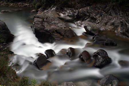 Downstream river rapids Stock Photo