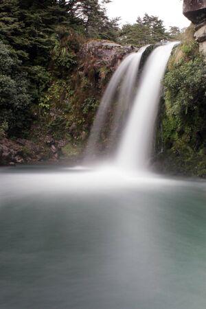 Waterfall cascades into pool below Stock Photo - 392899