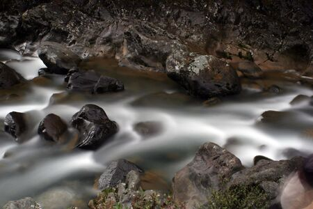 Water flowing through rocks Stock Photo - 402749