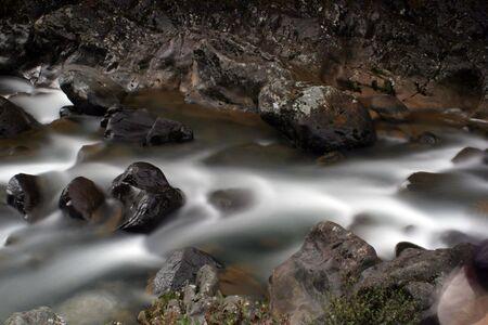 Water flowing through rocks Stock Photo - 402749