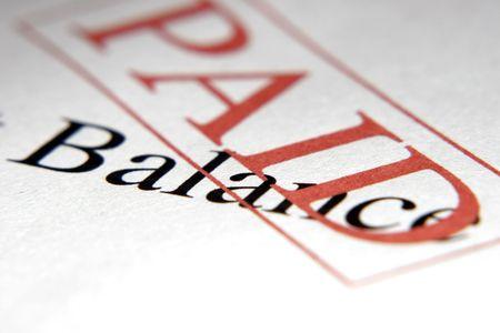 Paid stamp on Balance Stock Photo