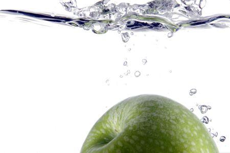 Part green apple splashing into water Stock Photo