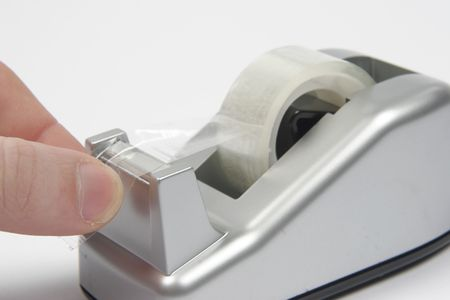 sticky tape holder and hand Stock Photo - 566734