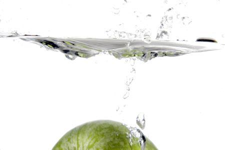 apple splashing into wate