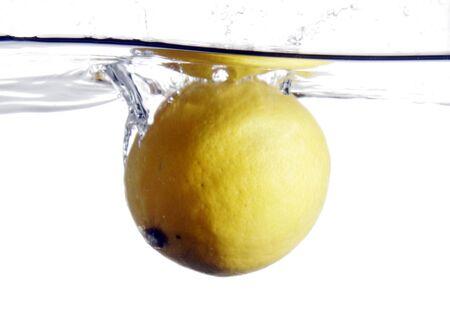 Lemon splashing into water Stock Photo - 566730