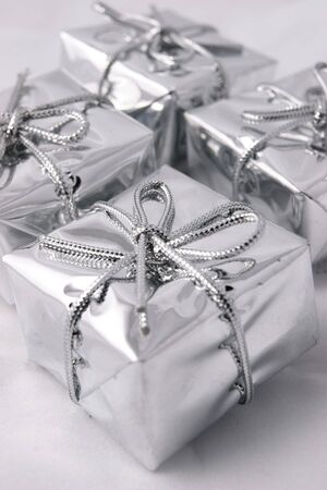 Silver presents with shallow focus on front present of four Stock Photo