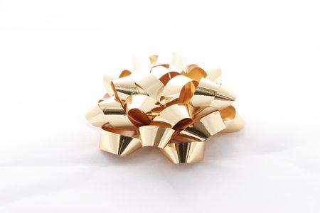 Golden christmas bow on white background Stock Photo